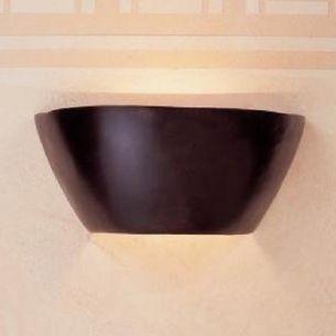 Wandleuchte aus Bronzeguss  mit  Lichtaustritt nach oben und unten
