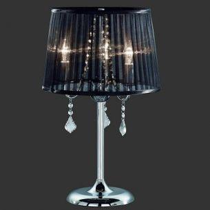 Extravagante Tischleuchte mit schwarzem Organzastoff und Acrylbehang